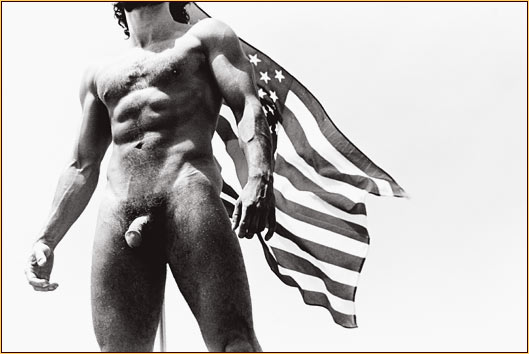 Tom Bianchi original gelatin silver print depicting a male nude standing in front of the American flag
